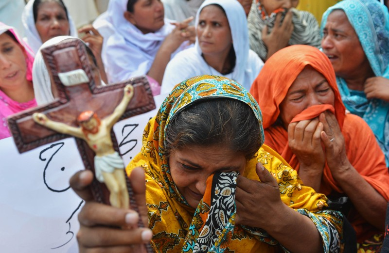 Pakistani Christians protest against the suicide bombing in All Saints church in the northwestern city of Peshawar on September 23, 2013. The death toll from a double suicide bombing on a church in Pakistan rose to 81, as Christians protested across the country to demand better protection for their community.  AFP PHOTO/ A MAJEED        (Photo credit should read A Majeed/AFP/Getty Images)