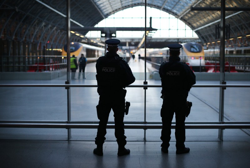 LONDON, ENGLAND - JANUARY 08:  Armed British Transport Police officers patrol the Eurostar platforms at St Pancras railway station on January 8, 2015 in London, United Kingdom.  France is on maximum security threat level after twelve people were killed, including two police officers, at the offices of the satirical magazine Charlie Hebdo in Paris.  (Photo by Peter Macdiarmid/Getty Images)
