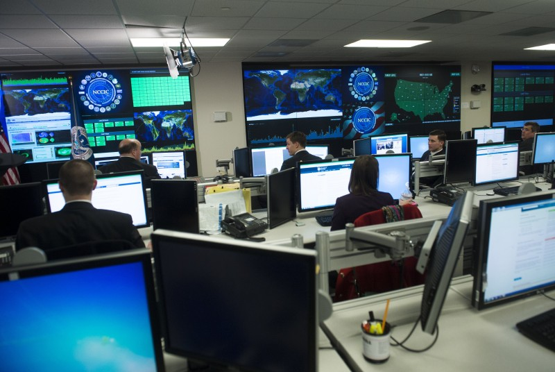 Staff members sit at their work stations at the National Cybersecurity and Communications Integration Center in Arlington, Virginia, January 13, 2015. US President Barack Obama visited the facility to talk about cyber security. AFP PHOTO / SAUL LOEB        (Photo credit should read SAUL LOEB/AFP/Getty Images)