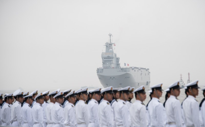 The French navy command ship Dixmude is welcomed by Chinese soldiers upon its arrival at the Wusong naval port of Shanghai on May 9, 2015. The LHD Dixmude is in Shanghai for a port visit during a five month Jeanne Darc mission.  AFP PHOTO / JOHANNES EISELE        (Photo credit should read JOHANNES EISELE/AFP/Getty Images)