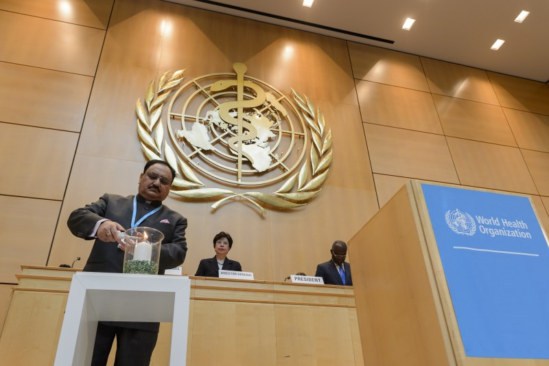 Indian Minister of Health and Family Welfare and President of the assembly, Jagat Prakash Nadda lights a candle in memory of the deceased health workers at the World Health Organization (WHO) assembly on May 18, 2015 in Geneva.  AFP PHOTO / FABRICE COFFRINI        (Photo credit should read FABRICE COFFRINI/AFP/Getty Images)