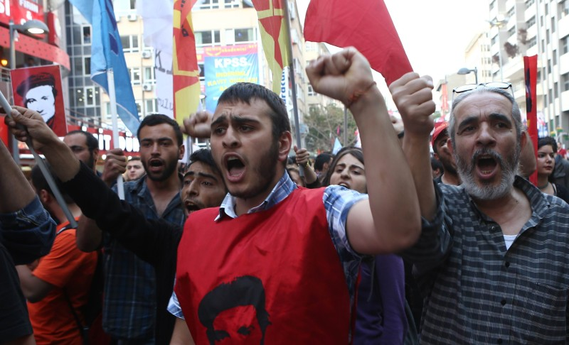 Supporters of People's Democratic Party (HDP) take part in a protest in Ankara on May 18, 2015 against the goverment and the twin attacks in southern Turkey. Twin bomb attacks hit the regional headquarters of Turkey's main pro-Kurdish party in two cities, injuring more than half a dozen people and escalating tensions ahead of June 7 legislative elections. AFP PHOTO / ADEM ALTAN        (Photo credit should read ADEM ALTAN/AFP/Getty Images)