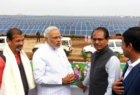 India's Bharatiya Janata Party (BJP) prime ministerial candidate and western Gujarat state Chief Minister Narendra Modi (2nd L) interacts with India's Madhya Pradesh state Chief Minister Shivraj Singh Chouhan (2nd R) after offficiating the solar energy plant at Bhagwanpura, Diken district Neemuch, some 480 kms from Madhya Pradesh' state capital Bhopal, on February 26, 2014. Modi inaugurated the solar energy plant which is spread over 1,000 acres of land. AFP PHOTO/STR        (Photo credit should read STRDEL/AFP/Getty Images)
