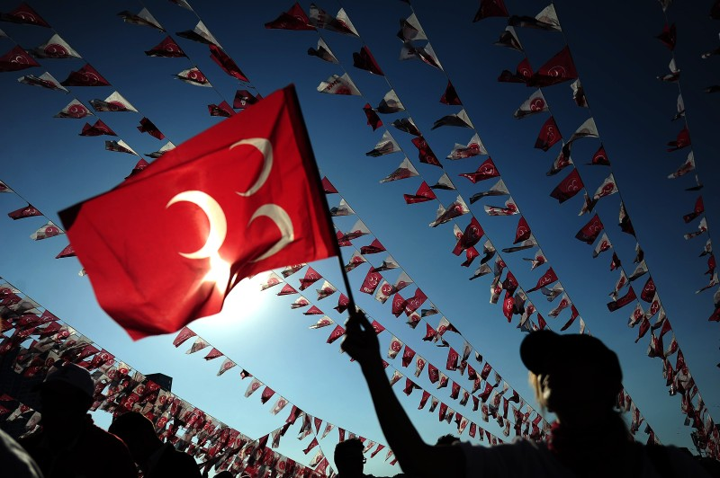 A woman waves a flag of Turkeys Nationalist Movement Party (MHP) during an election campaign rally on May 31, 2015 at Kazlicesme neighborhood in Istanbul ahead of the June 7 general elections. Turkish police tightened security around Istanbul's Taksim square, on the second anniversary of the mass anti-government protests that rocked the square in 2013. AFP PHOTO/OZAN KOSE        (Photo credit should read OZAN KOSE/AFP/Getty Images)