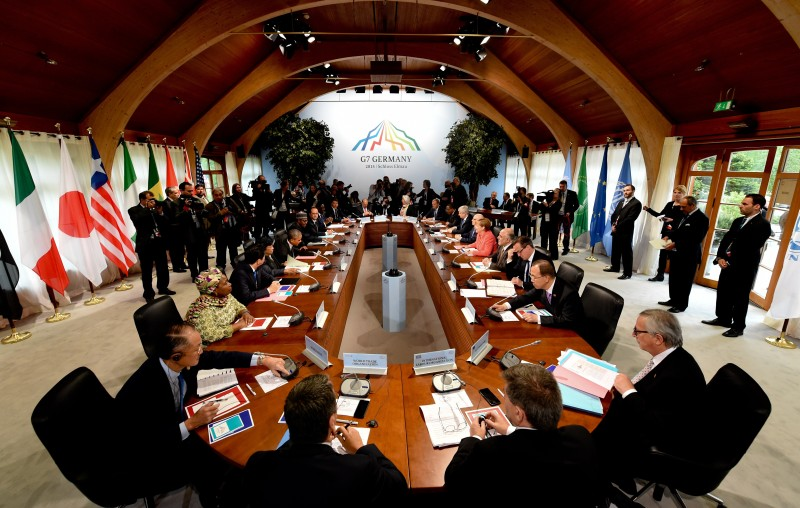 (L-clockwise) World Bank Group President  Jim Kim, Chair of the Commission of the African Union  Dlamini Zuma, Japanese Prime Minister Shinzo Abe, Liberia's President Ellen Johnson Sirleaf, US President  Barack Obama, Nigerian President Muhammadu Buhari, French President Francois Hollande, Senegal's President Macky Sall, Italy's Prime Minister Matteo Renzi, OECD secretary general  Jose Angel Gurria, IMF Managing Director  Christine Lagarde, President of the European Council Donald Tusk, Ethiopia's Prime Minister  Hailemariam Desalegn, Canada's Prime Minister Stephen Harper, Tunisia's President  Beji Caid Essebsi, Germany's Chancellor Angela Merkel, Iraq's Prime Minister  Haider al-Abadi, British Prime Minister David Cameron, United Nations Secretary-General  Ban Ki-moon and European Union Commission President Jean-Claude Juncker attend the so called 'outreach meeting' on the second day of the G7 summit at the Elmau Castle near Garmisch-Partenkirchen, southern Germany, on June 8, 2015.  AFP PHOTO / POOL / SVEN HOPPE        (Photo credit should read SVEN HOPPE/AFP/Getty Images)