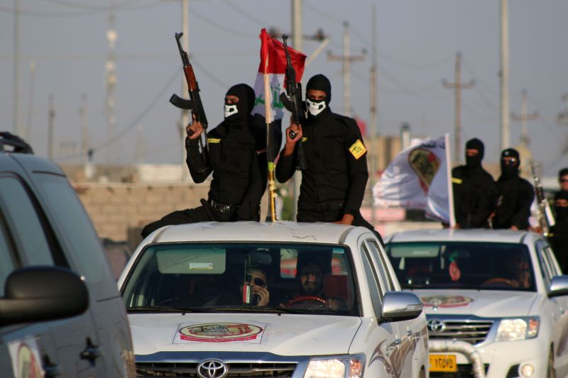 Fighters of the Ansar Allah al-Awfiya (Loyal Supporters of God) Shiite group parade with their weapons on June 16, 2015 in the southern Iraqi city of Basra during celebrations marking one year after a fatwa from Iraq's top Shiite cleric, Grand Ayatollah Ali al-Sistani, rallied Iraq's majority Shiites against the Sunni Muslim jihadist-led insurgency in Iraq. Islamic State (IS) group spearheaded an offensive that overran a third of Iraq last year, sweeping Baghdad's forces aside, and the jihadists proved they are still capable of gaining ground when they overran Anbar provincial capital Ramadi last month.  AFP PHOTO / HAIDAR MOHAMMED ALI        (Photo credit should read HAIDAR MOHAMMED ALI/AFP/Getty Images)