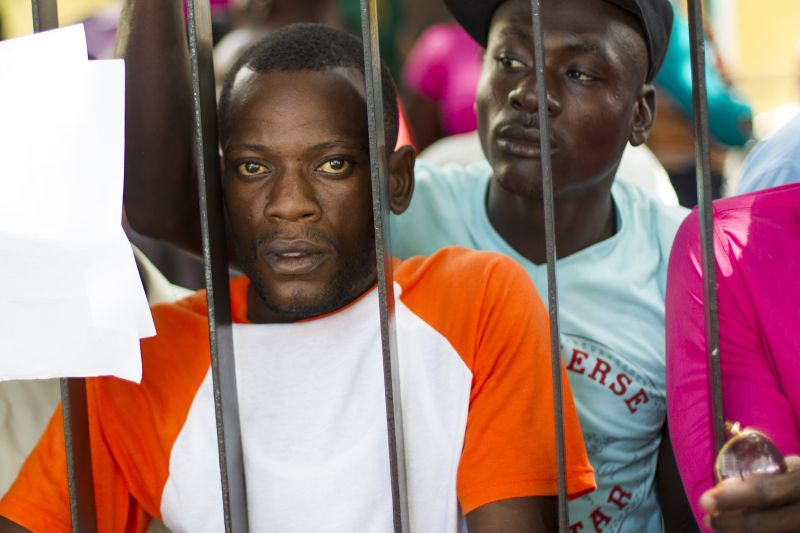 Haitians queue up to legalize their status at the Interior Ministry in Santo Domingo, on June 16, 2015. Tens of thousands of people are facing deportations as a deadline for foreigners, most of them being Haitians, to legalize their status as undocumented alien is due to expire on 17 June 2015. AFP PHOTO/ERIKA SANTELICES        (Photo credit should read ERIKA SANTELICES/AFP/Getty Images)