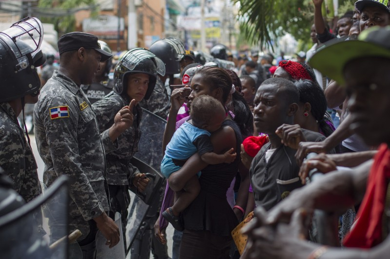 Haitians queue up to legalize their status at the Interior Ministry in Santo Domingo, on June 17, 2015. Tens of thousands of people are facing deportations as a deadline for foreigners, most of them being Haitians, to legalize their status as undocumented alien is due to expire midnight. AFP PHOTO / ERIKA SANTELICES        (Photo credit should read ERIKA SANTELICES/AFP/Getty Images)