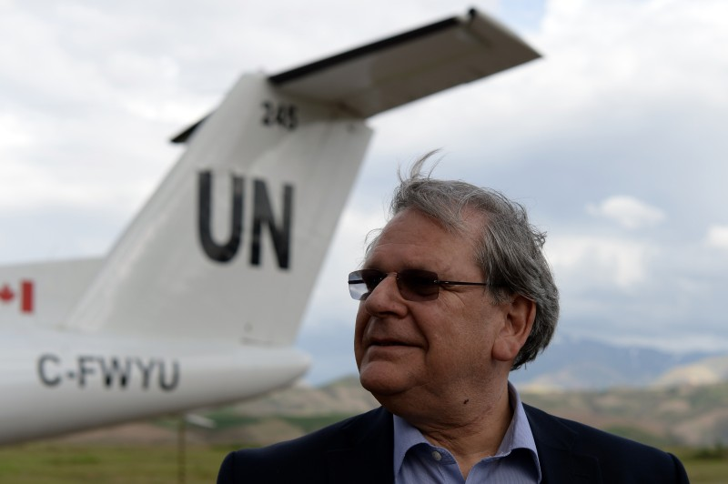 UN humanitarian coordinator, Mark Bowden prepares to leave following his visit to the landslide-affected area in Badakhshan province on May 5, 2014. Afghan officials said they plan to build new houses for hundreds of families made homeless by a landslide that entombed a northeastern village and killed at least 300 people. AFP PHOTO/WAKIL KOHSAR        (Photo credit should read WAKIL KOHSAR/AFP/Getty Images)