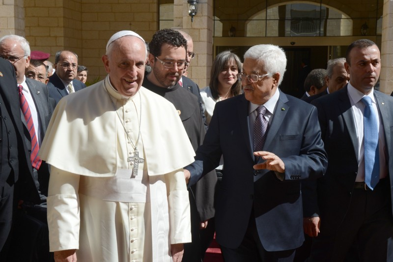 "RAMALLAH, WEST BANK - MAY 25: In this handout image supplied by the Palestinian Press Ofiice (PPO) Palestinian President Mahmoud Abbas greets Pope Francis on May 25, 2014, Ramallah, West Bank. Pope Francis addressed the Israeli-Palestinian conflict as ""unacceptable"" and urged both sides to find courage in seeking a peaceful solution.  (Photo by Thaer Ghanaim/PPO via Getty Images)"