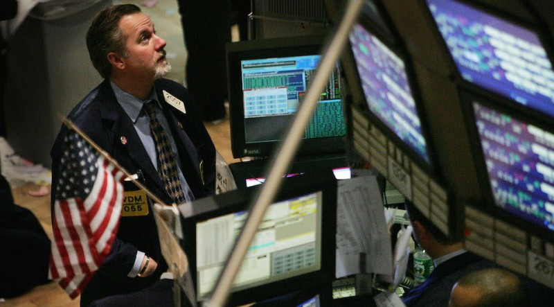 NEW YORK - FEBRUARY 16:  A trader works on the floor of New York Stock Exchange February 16, 2005 in New York City. The dollar fell against the euro even after Federal Reserve Chairman Alan Greenspan announced further hikes in U.S. interest rates.  (Photo by Mario Tama/Getty Images)