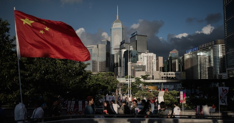 A Chinese national flag set up by demonstrators supporting the government electoral roadmap is seen outside the city's legislature in Hong Kong on June 17, 2015.  Hong Kong lawmakers laid bare the city's entrenched political divide as they locked horns over a reform package ahead of a key vote that pits democracy campaigners against the government.  AFP PHOTO / Philippe Lopez        (Photo credit should read PHILIPPE LOPEZ/AFP/Getty Images)