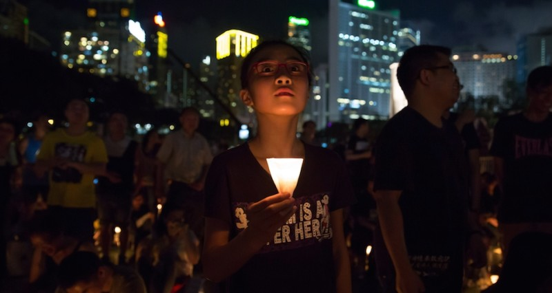 "People take part in a candlelight vigil in Hong Kong on June 4, 2015, to mark the crackdown on the pro-democracy movement in Beijing's Tiananmen Square in 1989. Tens of thousands were expected to mark the 26th anniversary of the Tiananmen Square crackdown, organisers said, as they call on people to ""stay united"" as the city faces frustrations over its own democratic reforms.  AFP PHOTO / DALE DE LA REY        (Photo credit should read DALE de la REY/AFP/Getty Images)"