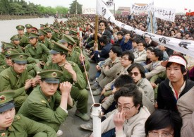 BEIJING, CHINA - APRIL 22:  Picture dated 22 April 1989 shows several hundred of 200,000 pro-democracy student protesters face to face with policemen outside the Great Hall of the People in Tiananmen Square in Beijing as they take part in the funeral ceremony of former Chinese Communist Party leader and liberal reformer Hu Yaobang during an unauthorized demonstration to mourn his death.  Hu Yaobang's death in April trigged an unprecedented wave of pro-democracy demonstrations. The April-June 1989 movement was crushed by Chinese troops in June when army tanks rolled into Tiananmen Square 04 June.         AFP PHOTO  (Photo credit should read CATHERINE HENRIETTE/AFP/Getty Images)