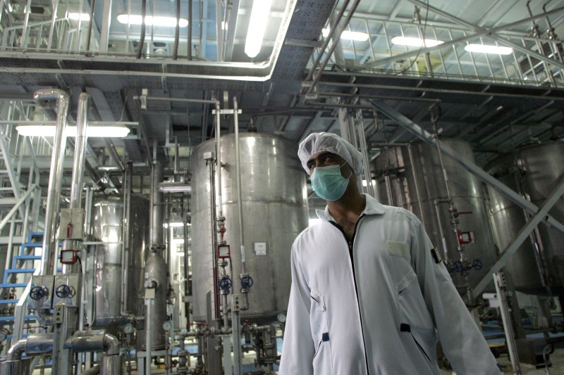 An Iranian technician works at the Isfahan Uranium Conversion Facilities (UCF), 420 kms south of Tehran, 03 February 2007. Iran opened the doors to its uranium conversion plant today in a bid to show its good intentions amid mounting international pressure for a halt its controversial nuclear programme. A delegation of Non-Aligned Movement (NAM) and Group of 77 representatives arrived at the facility in the central city of Isfahan together with foreign and Iranian journalists for a guided tour.  AFP PHOTO/BEHROUZ MEHRI (Photo credit should read BEHROUZ MEHRI/AFP/Getty Images)