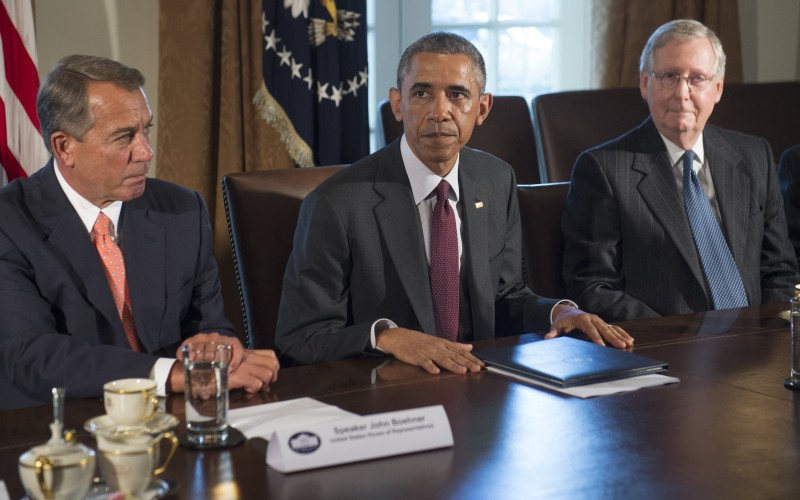 US President Barack Obama (C) speaks alongside Speaker of the House John Boehner (L), Republican of Ohio, and Senate Majority Leader Mitch McConnell (R), Republican of Kentucky, prior to a meeting of the bipartisan, bicameral leadership of Congress in the Cabinet Room at the White House in Washington, DC, January 13, 2015. AFP PHOTO / SAUL LOEB        (Photo credit should read SAUL LOEB/AFP/Getty Images)