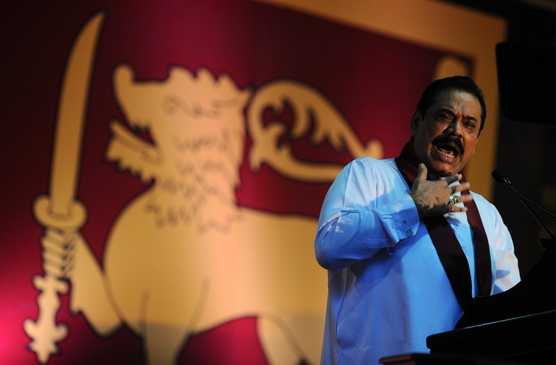 Sri Lanka's former president Mahinda Rajapaksa speaks in Colombo on May 18, 2015 in commemoration of those who died six years ago in battles between Liberation Tigers of Tamil Eelam (LTTE) fighters and government troops at the end of the three decades old separatist conflict.  Rajapaksa urged against any separatist wars in the future. The sixth anniversary of the killing of Liberation Tigers of Tamil Eelam (LTTE) leader Velupillai Prabhakaran is being marked in the first anniversary of the event under the new government of President Sirisena. AFP PHOTO / ISHARA S. KODIKARA        (Photo credit should read Ishara S.KODIKARA/AFP/Getty Images)