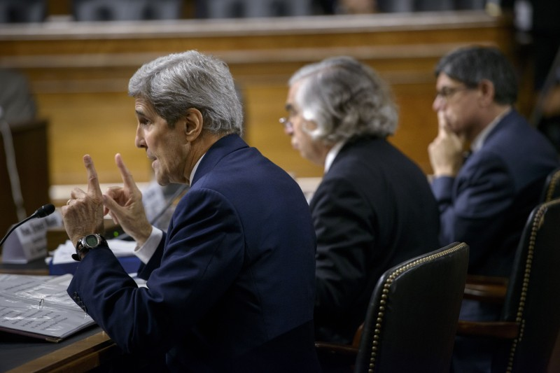 US Secretary of State John Kerry (L) speaks while US Secretary of Energy Ernest Moniz (C) and US Secretary of the Treasury Jacob Lew (R) listen during a hearing of the Senate Foreign Relations Committee on Capitol Hill July 23, 2015 in Washington, DC. US Secretary of State John Kerry, US Secretary of Energy Ernest Moniz and US Secretary of the Treasury Jacob Lew appeared before the committee to defend the Obama administrations proposed deal with Iran over the county's nuclear program. AFP PHOTO/BRENDAN SMIALOWSKI        (Photo credit should read BRENDAN SMIALOWSKI/AFP/Getty Images)