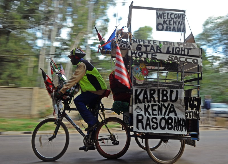 "An man rides a bicycle and a trailer with messages reading ""welcome Kenya Obama"" in Nairobi on July 23, 2015, on the eve of the US President's visit. On the eve of his trip to Africa, US President Barack Obama said he was excited about the impending visit to his ancestral continent, which he said had great resilience and enormous potential for growth. AFP PHOTO / TONY KARUMBA        (Photo credit should read TONY KARUMBA/AFP/Getty Images)"