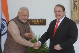 India's newly sworn-in Prime Minister Narendra Modi (L) gestures to Pakistani Prime Minister Nawaz Sharif as they shake hands during a meeting in New Delhi on May 27, 2014. Indian Prime Minister Narendra Modi met his Pakistani counterpart Nawaz Sharif for landmark talks in New Delhi May 27 in a bid to ease tensions between the nuclear-armed neighbours. AFP PHOTO/RAVEENDRAN        (Photo credit should read RAVEENDRAN/AFP/Getty Images)