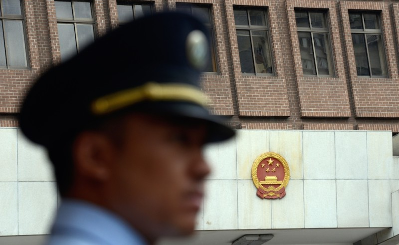 A policeman stands guard at the Shanghai Intermediate Court on August 8, 2014.  Peter Humphrey, a British investigator once hired by scandal-hit pharmaceutical giant GSK in China, did not dispute accusations that he had breached privacy laws as he went on trial on August 8, the court said. Peter Humphrey and his US wife Yu Yingzeng were hired to investigate the source of a lurid sex tape of the China boss of GlaxoSmithKline (GSK), shortly before the British firm became embroiled in bribery allegations.      AFP PHOTO / JOHANNES EISELE        (Photo credit should read JOHANNES EISELE/AFP/Getty Images)