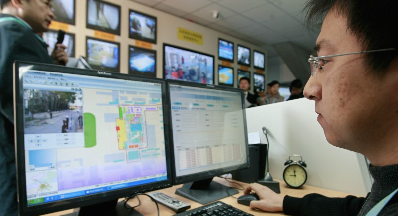A security official monitors computer screens displaying a map of Beijing 2008 Olympic games venues security, at a security command center of the University of Science and Technology Gymnasium in Beijing, 16 November 2007.  Israeli police will provide training for Chinese police in counterterrorism and crowd control ahead of the upcoming Olympic games in Beijing, a police spokesman said on 11 November. AFP PHOTO/TEH ENG KOON (Photo credit should read TEH ENG KOON/AFP/Getty Images)