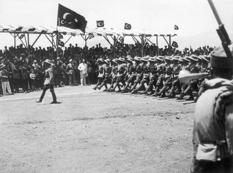 TURKEY - JUNE 23:  Turkish troops marching in front of French militarymen in the region of Alexandretta (now called Iskenderun). This territory which belonged to Syria was gave up by France for Turkey not to go to war on the German side.  (Photo by Keystone-France/Gamma-Keystone via Getty Images)