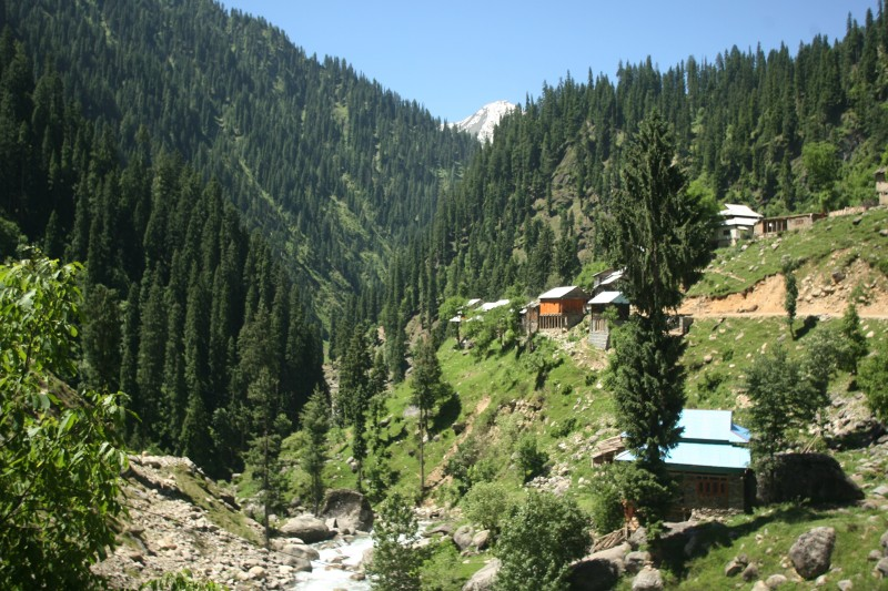 TO GO WITH Lifestyle-Pakistan-unrest-tourism,FEATURE by Sajjad Qayyum In this photograph taken on June 9, 2013, shows a view of tourist huts in the mountainous Neelum valley in Pakistani controlled Kashmir. Success stories can be rare in Pakistan, but business is booming in a new holiday resort in Kashmir as the region rebuilds after a devastating earthquake and shrugs off associations with violence. AFP PHOTO / SAJJAD QAYYUM        (Photo credit should read SAJJAD QAYYUM/AFP/Getty Images)