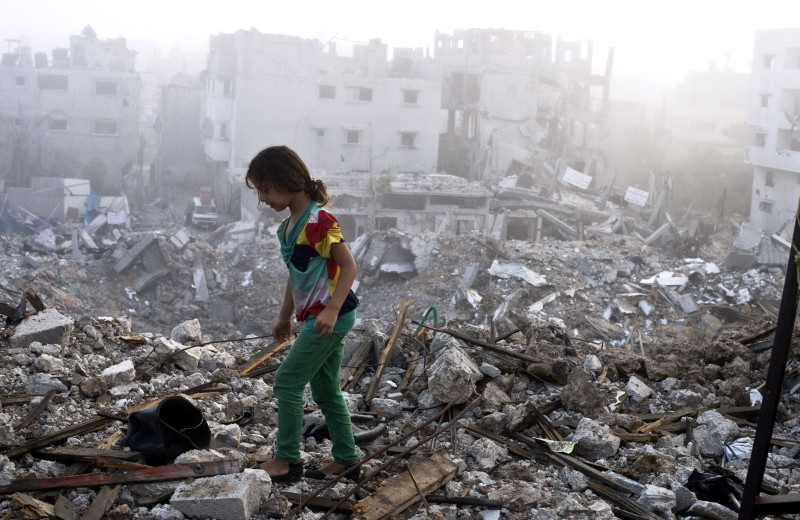 A Palestinian girl walks on the rubble strewn cieling of her family's home after she and other members of her family returned to their partially destroyed house early on August 27, 2014 in Gaza City's Shejaiya neighbourhood which was one of the hardest hit by the fighting. The skies over the Gaza Strip were calm as a long-term ceasefire between Israel and the Palestinians took hold after 50 days of the deadliest violence in a decade.  AFP PHOTO/ROBERTO SCHMIDT        (Photo credit should read ROBERTO SCHMIDT/AFP/Getty Images)