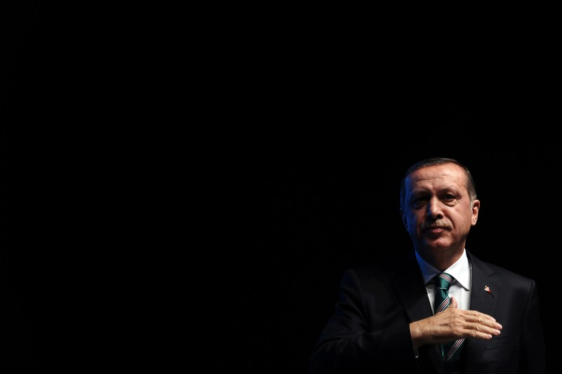 Turkish prime minister Recep Tayyip Erdogan stands on stage after a speech at the end of a ceremony marking the anniversary of the death of Jelaleddin Mevlana Rumi, Sufi mystic, poet and founder of the sufism, on December 13,2013, at Ulker Sports Arena in Istanbul. The dervishes are adepts of Sufism, a mystical form of Islam that preaches tolerance and a search for understanding. Those who whirl, like planets around the sun, turn dance into a form of prayer. Some say the whirling dervishes belong more to the central, conservative city of Konya, where the father of Sufism, Mevlana Jalaluddin Rumi, lived in the 13th century, than to the cosmopolitan modern city. AFP PHOTO / OZAN KOSE        (Photo credit should read OZAN KOSE/AFP/Getty Images)