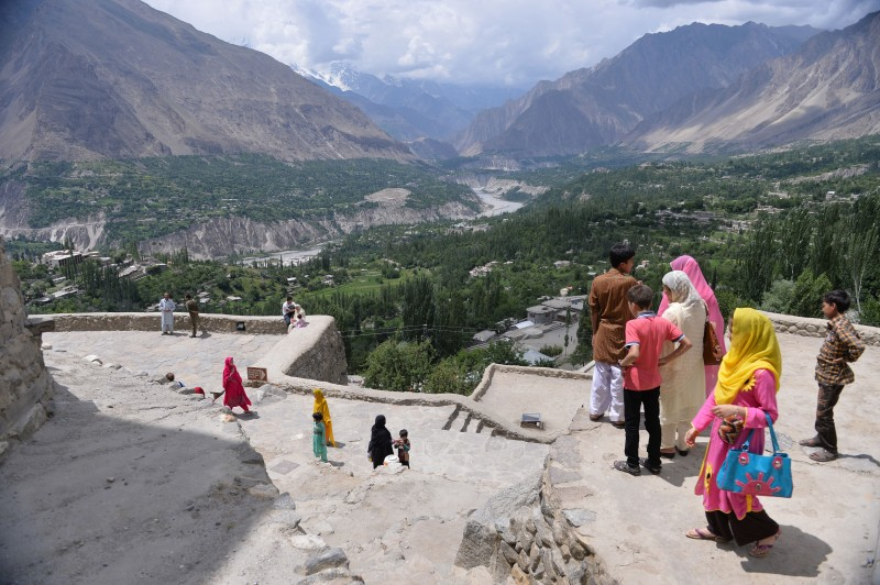 Tourists visit at the Baltit fort in Karimabad, a town of northern Hunza valley on August 3, 2014.  After a slump in tourism that has lasted more than a decade, the streets of Karimabad in Pakistan's idyllic northern Hunza Valley are bursting once again with visitors enjoying the city's sights and sounds -- but the locals aren't happy.           AFP PHOTO/ Aamir QURESHI        (Photo credit should read AAMIR QURESHI/AFP/Getty Images)