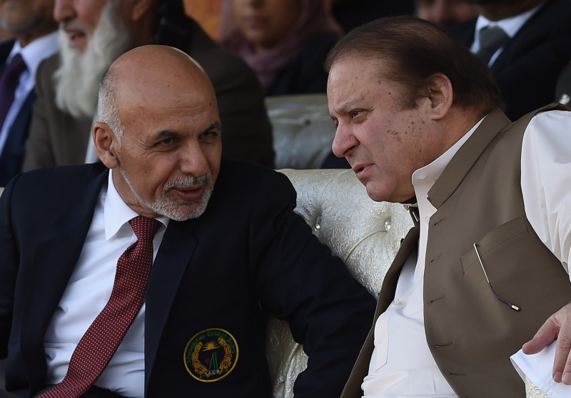 Pakistani Prime Minister Nawaz Sharif (R) and Afghan President Ashraf Ghani (L) speak as they watch a cricket match between teams from Pakistan and Afghanistan at the Prime Minister's house in Islamabad on November 15, 2014. Pakistan and Afghanistan pledged to begin a new era of economic cooperation, with Afghan President Ashraf Ghani saying three days of talks had ended 13 years of differences. AFP PHOTO/Farooq NAEEM        (Photo credit should read FAROOQ NAEEM/AFP/Getty Images)
