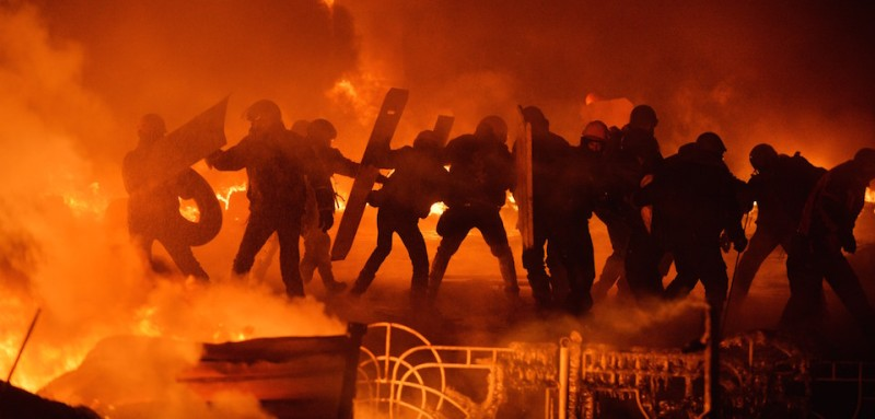 Anti-government protesters clash with the police in the center of Ukrainian capital Kiev during the night on  January 25, 2014. Violence broke out in Kiev again late Friday, with molotov cocktails flying in one direction and stun grenades in the other, but both sides stuck to their positions and the flare-up did not escalate into the running battles seen earlier in the week. AFP PHOTO/ SERGEI SUPINSKY        (Photo credit should read SERGEI SUPINSKY/AFP/Getty Images)