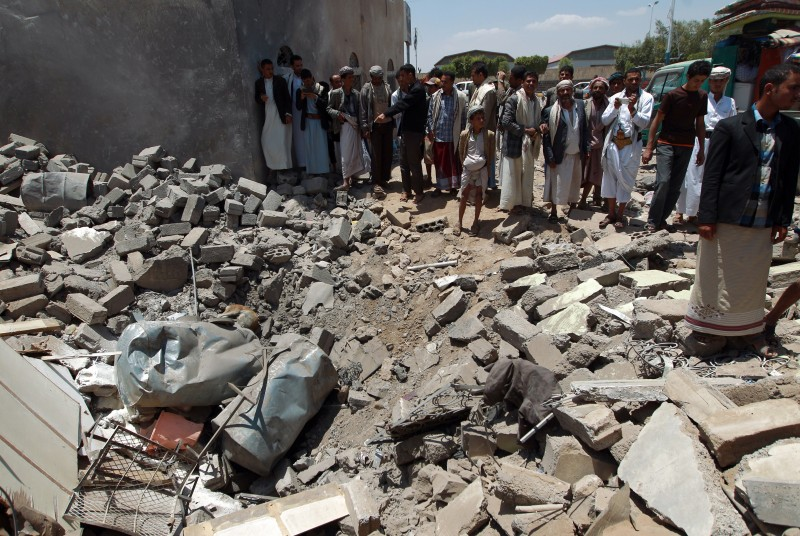 Yemenis gather near the rubble of houses near Sanaa Airport on March 31, 2015 which were destroyed by an air strike as Saudi-led coalition warplanes hit Shiite Huthi militia targets across Yemen overnight, targeting the group's northern stronghold of Saadeh, the capital, Sanaa, and the central town of Yarim, residents and media said. AFP PHOTO / MOHAMMED HUWAIS        (Photo credit should read MOHAMMED HUWAIS/AFP/Getty Images)