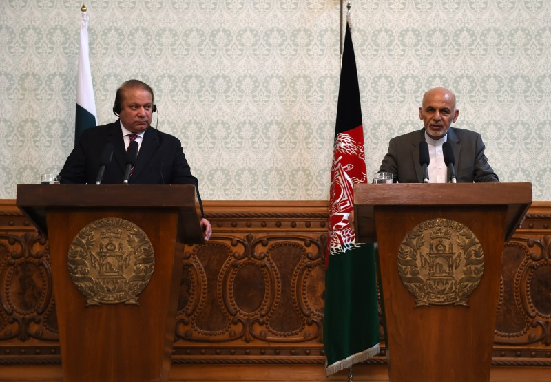 Afghan President Ashraf Ghani (R) speaks during a press conference while Pakistani Prime Minster Nawaz Sharif (L) looks on at the Presidential palace in Kabul on May 12, 2015. AFP PHOTO / SHAH Marai        (Photo credit should read SHAH MARAI/AFP/Getty Images)