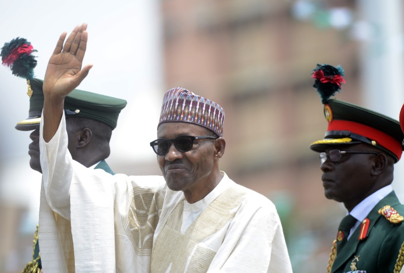 Nigeria's new President Mohammadu Buhari waves to the crowd during his inauguration at the Eagles Square in Abuja, on May 29, 2015. Buhari, 72, defeated Goodluck Jonathan in March 28 elections -- the first time in Nigeria's history that an opposition candidate had beaten a sitting president. AFP PHOTO/PIUS UTOMI EKPEI        (Photo credit should read PIUS UTOMI EKPEI/AFP/Getty Images)