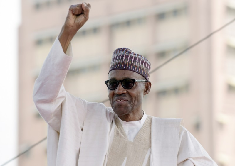 Nigerian President Mohammadu Buhari raises his fist to greet the crowd before taking oath of office at the Eagles Square in Abuja, on May 29, 2015. Buhari, 72, defeated Jonathan in March 28 elections -- the first time in Nigeria's history that an opposition candidate had beaten a sitting president. AFP PHOTO/PIUS UTOMI EKPEI        (Photo credit should read PIUS UTOMI EKPEI/AFP/Getty Images)