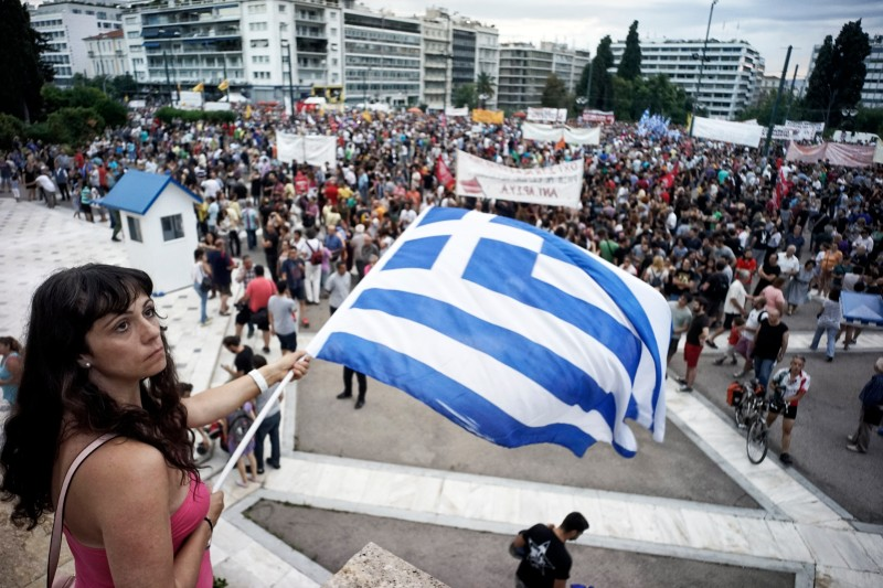ATHENS, GREECE - JUNE 21: Protesters attend  an anti-austerity pro-government rally in front of the parliament building  on June 21, 2015 in Athens, Greece. Greece's leftwing government believes it can reach a deal with its creditors on Monday. (Photo by Milos Bicanski/Getty Images)