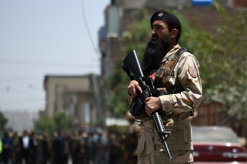An Afghan security personnel stands guard at the site of a bomb blast that targeted NATO forces in Kabul on July 7, 2015. A bomb blast targeted NATO forces in Kabul, a spokesman for the coalition told AFP, as the Taliban step up attacks as part of their annual summer offensive. AFP PHOTO / WAKIL KOHSAR        (Photo credit should read WAKIL KOHSAR/AFP/Getty Images)