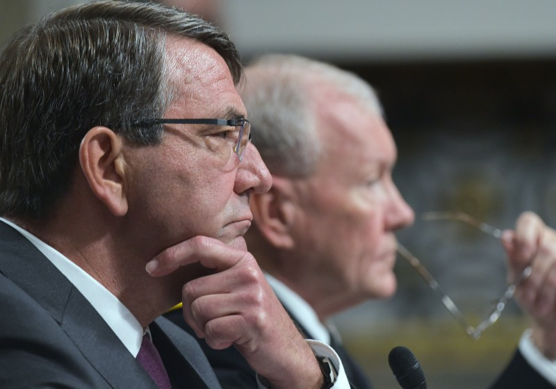 US Defense Secretary Ashton Carter (L) and Chairman of the Joint Chiefs of Staff Gen. Martin Dempsey testifiy before the Senate Armed Services Committeeabout the military campaign against the Islamic State on July 7, 2015 on Capitol Hill in Washington, DC. AFP PHOTO/MANDEL NGAN        (Photo credit should read MANDEL NGAN/AFP/Getty Images)
