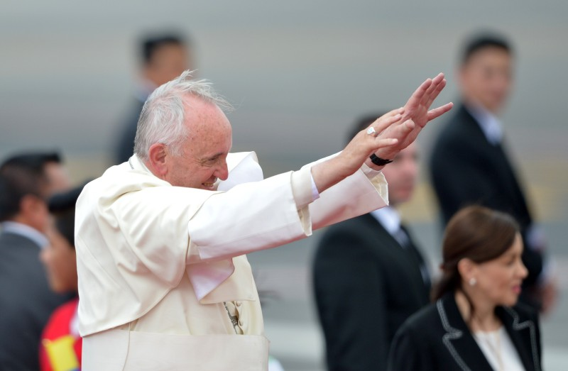 Pope Francis waves at the airport in Quito before his departure for Bolivia, on July 8, 2015. Pope Francis, the first Latin American pontiff, heads Wednesday to Bolivia on the second leg of a three-nation tour of the continent's poorest countries, where he has been acclaimed by huge crowds.     AFP PHOTO / MARTIN BERNETTI        (Photo credit should read MARTIN BERNETTI/AFP/Getty Images)