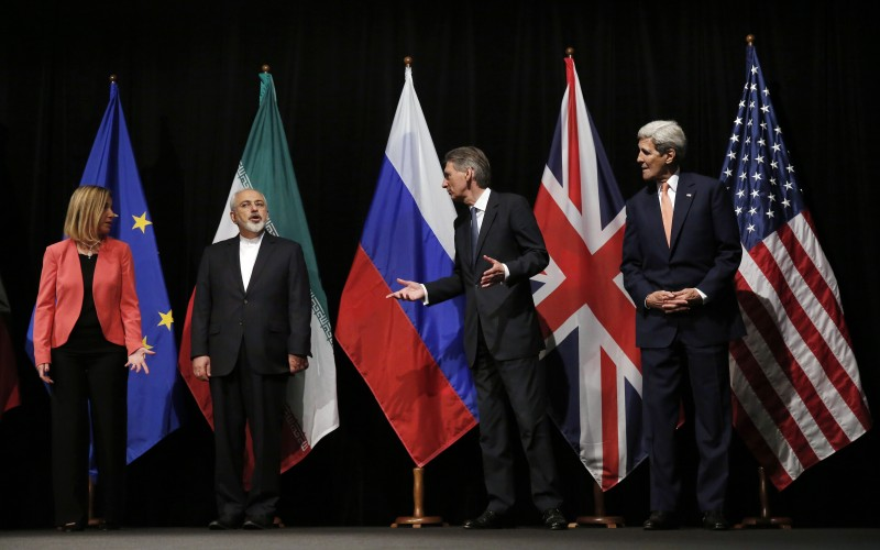 "British Foreign Secretary Philip Hammond (2nd R), US Secretary of State John Kerry (R) and European Union High Representative for Foreign Affairs and Security Policy Federica Mogherini (L) talk to Iranian Foreign Minister Mohammad Javad Zarif as the wait for the Russian Foreign Minister for a group picture at the Vienna International Center in Vienna, Austria July 14, 2015. Iran and six major world powers reached a nuclear deal on Tuesday, capping more than a decade of on-off negotiations with an agreement that could potentially transform the Middle East, and which Israel called an ""historic surrender"".      AFP PHOTO / POOL / CARLOS BARRIA        (Photo credit should read CARLOS BARRIA/AFP/Getty Images)"