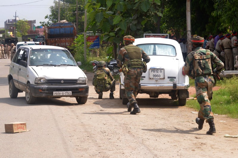 Indian Army personnel take position during an encounter with armed attackers at the police station in Dinanagar town, in the Gurdaspur district of Punjab state on July 27, 2015. Indian security forces were  battling an armed attack on a police station near the Pakistan border in which at least five people have been killed.   AFP PHOTO/ NARINDER NANU        (Photo credit should read NARINDER NANU/AFP/Getty Images)