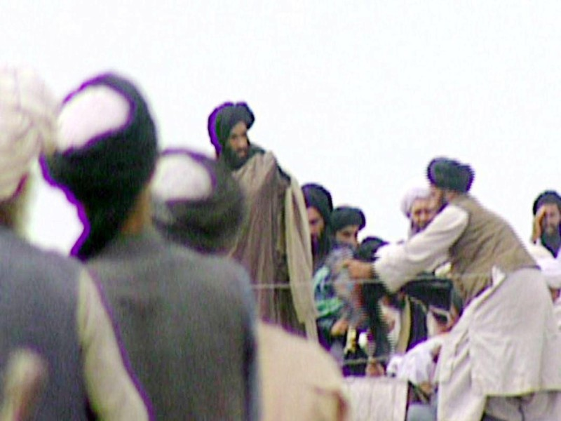 KANDAHAR, AFGHANISTAN:  TV grabs taken secretly by BBC Newsnight shows Taliban's one-eyed spiritual leader Mullah Mohammed Omar (C) during a rally of his troops in Kandahar before their victorious assault on Kabul in 1996. AFP PHOTO            MANDATORY CREDIT BBC NEWS/NEWSNIGHT (Photo credit should read AFP/Getty Images)