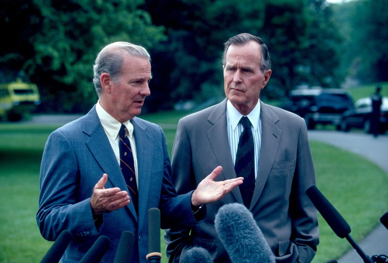 100973 05: (FILE PHOTO) Secretary of State James Baker talks with U.S. President George Bush at a press conference May 17, 1991 in Washington DC. (Photo by Diana Walker/Liaison Agency)