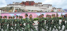 Chinese paramilitary policemen patrol in front of the Potala Palace during the ceremony for the 2008 Beijing Olympic Games torch relay in Lhasa on June 21, 2008. The latest leg of the Olympic torch relay was held in the Tibetan capital June 21, amid tight security after deadly riots against Chinese rule three months ago, as rights groups condemned the event. AFP PHOTO/TEH Eng Koon (Photo credit should read TEH ENG KOON/AFP/Getty Images)
