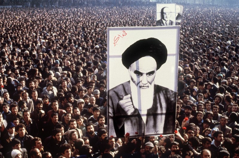TO GO WITH AFP STORY BY PIERRE CELERIER  (FILES) -- In a file picture taken in January 1979, Iranian protestors hold a up a poster of Ayatollah Ruhollah Khomeini during a demonstration in Tehran against the Shah. Iran will begin 10 days of celebrations on February 1, 2009, marking the 30th anniversary of the return of the exiled Ayatollah Ruhollah Khomeini and the revolution which toppled the US-backed shah. AFP PHOTO/STR (Photo credit should read -/AFP/Getty Images)
