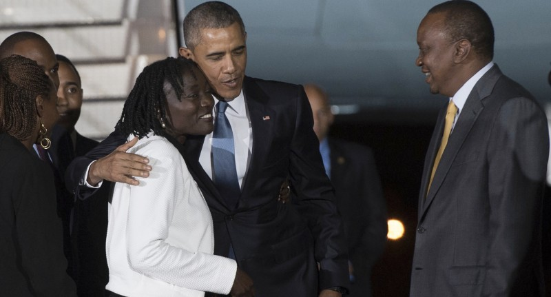 US President Barack Obama (C) greets his half-sister Auma Obama (L) alongside Kenyan President Uhuru Kenyatta upon his arrival at Kenyatta International Airport in Nairobi on July 24, 2015. US President Barack Obama arrived in Kenya late today, his first visit to the country of his father's birth since his election as president.  AFP PHOTO / SAUL LOEB        (Photo credit should read SAUL LOEB/AFP/Getty Images)