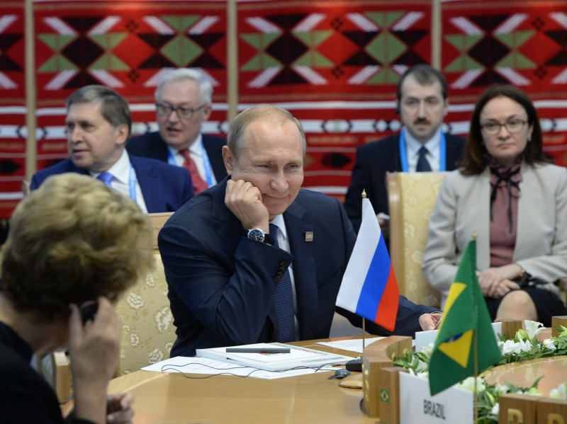 UFA, RUSSIA - JULY 9:  In this handout image supplied by Host Photo Agency / RIA Novosti, President of the Russian Federation Vladimir Putin at a BRICS leaders limited attendance meeting during the BRICS/SCO Summits - Russia 2015 on July 09, 2015 in Ufa, Russia. (Photo by Iliya Pitalev / Host Photo Agency/Ria Novosti via Getty Images)