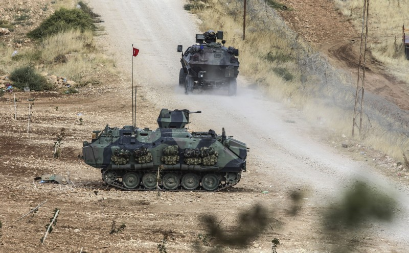 Turkish tanks man a position facing the Islamic State (IS) fighters' new position, 10km west of the Syrian city of Ain al-Arab (Kobane) near the Syrian border at the southeastern town of Suruc in the Sanliurfa province on October 2, 2014. Islamic State fighters were at the gates on October 2 of a key Kurdish town on the Syrian border with Turkey, whose parliament was set to vote on authorising military intervention against the jihadists. Kurdish militiamen backed by US-led air strikes were locked in fierce fighting to prevent the besieged border town of Kobane from falling to IS group fighters. AFP PHOTO/BULENT KILIC        (Photo credit should read BULENT KILIC/AFP/Getty Images)